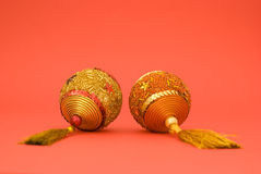 Golden Christmas balls. On red background Royalty Free Stock Photo