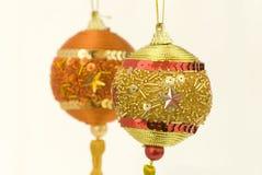 Golden Christmas balls. Two Christmas golden balls closeup Royalty Free Stock Photos