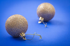 Golden christmas balls on blue background Royalty Free Stock Photography