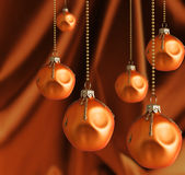 Golden Christmas balls with blur shiny background Royalty Free Stock Images