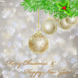 Golden Christmas balls with Christmas light Stock Photography
