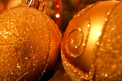 Golden Christmas balls closeup Stock Photography