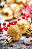 Golden Christmas balls on festive background Stock Photo