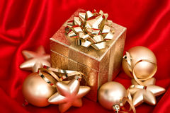 Golden christmas balls and gift box. festive decoration Royalty Free Stock Photography