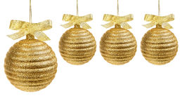 Golden christmas balls with golden ribbon Royalty Free Stock Photography