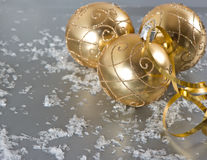 Golden christmas balls with golden streamer Stock Image
