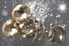 Golden christmas balls with golden streamer Royalty Free Stock Images