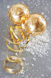 Golden christmas balls with golden streamer Royalty Free Stock Photos