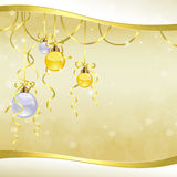 Golden Christmas balls. Hanging over golden background Stock Images