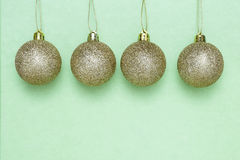 Golden Christmas balls hanging Stock Photos