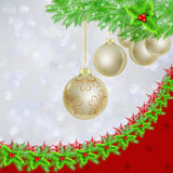 Golden Christmas balls over Christmas lights Royalty Free Stock Images