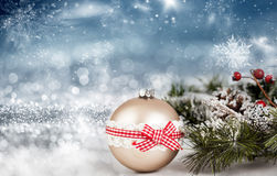 Golden Christmas balls over sparkling holiday background Royalty Free Stock Photography