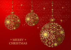 Golden christmas balls  on a red background. Golden christmas balls with snowflakes on a red background. Holiday card Royalty Free Stock Photography