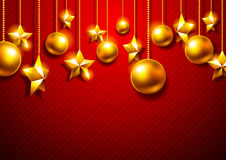 Golden Christmas balls on a red background. Christmas toy with golden stars on a red background Royalty Free Stock Photo