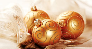 Golden christmas balls with ribbon Royalty Free Stock Photography