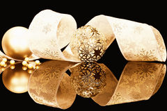 Golden christmas balls with ribbon Stock Photos