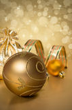 Golden Christmas balls and ribbon Stock Image