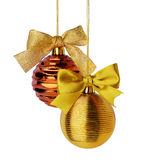 Golden Christmas balls with ribbon bows. Hanging over white background Stock Image