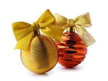Golden Christmas balls with ribbon bows. Isolated on white background Stock Photo