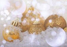 Golden Christmas balls in the snow Royalty Free Stock Photos