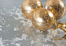 Golden christmas balls with snow decoration Stock Photo
