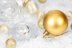 Golden Christmas balls and star on icy background Royalty Free Stock Image