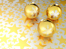 Golden Christmas balls with stars Royalty Free Stock Image