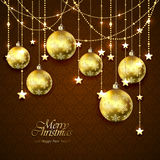 Golden Christmas balls and stars on brown background Royalty Free Stock Photo