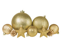 Golden Christmas balls, stars and fir cone. On a white background Stock Photography