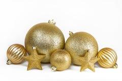 Golden Christmas balls and stars Royalty Free Stock Image