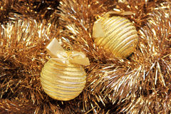 Golden christmas balls on a tinsel Stock Photography