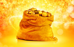 Golden christmas balls and toys in Santa bag Royalty Free Stock Photography