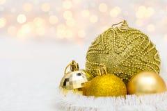 Golden Christmas balls on white Stock Photography