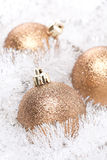 Golden Christmas balls in white tinsel, selective focus Royalty Free Stock Photos