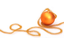 Golden christmas bauble with ribbon. On isolated white background Royalty Free Stock Images