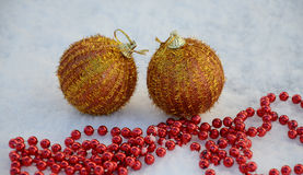Golden  Christmas bauble on snow Royalty Free Stock Photos