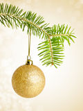 Golden christmas bauble on a string Stock Images