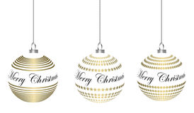 Golden christmas baubles hanging. Lettering merry christmas Stock Photos