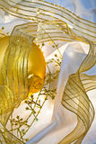 Golden Christmas Baubles and Ribbons Stock Photos