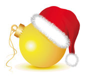 Golden Christmas baubles with Santa Claus Hat. Golden Christmas ball, Christmas ball , Christmas baubles,santa claus hat, red hat, red cap,   fir twigs Royalty Free Stock Photography