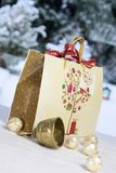 Golden Christmas bell, balls and gift bag Royalty Free Stock Photo