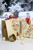 Golden Christmas bell, balls and gift bag Royalty Free Stock Photos