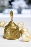 Golden Christmas bell and Christmas balls Stock Image