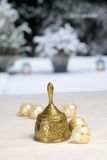 Golden Christmas bell and Christmas balls Royalty Free Stock Photography