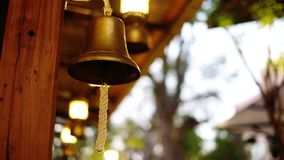 Golden christmas bell. Hanging defocused decoration Royalty Free Stock Images