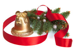 Golden Christmas Bell with Pine and Ribbon Stock Image