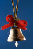Golden Christmas bell with red ribbons Royalty Free Stock Photos