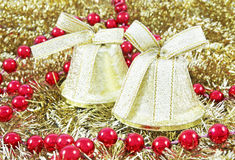 Golden Christmas bells. And golden background Royalty Free Stock Photos