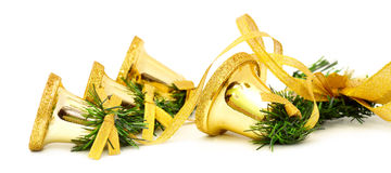 Golden christmas bells. Isolated on white background Stock Images
