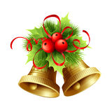 Golden Christmas bells with Holly berries, tinsel Royalty Free Stock Images